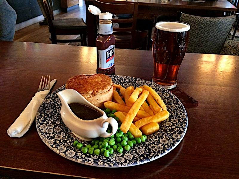 Pork Pie, chips, peas, & gravy
