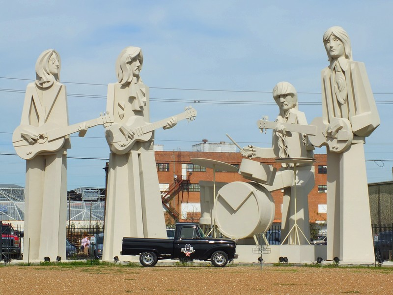 "8th Wonder's calls their outdoor space ""WonderWorld"" -- this huge Beatles sculpture dominates one corner"