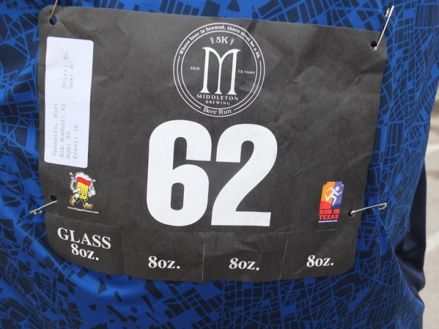 Bib number tag includes tear off coupons