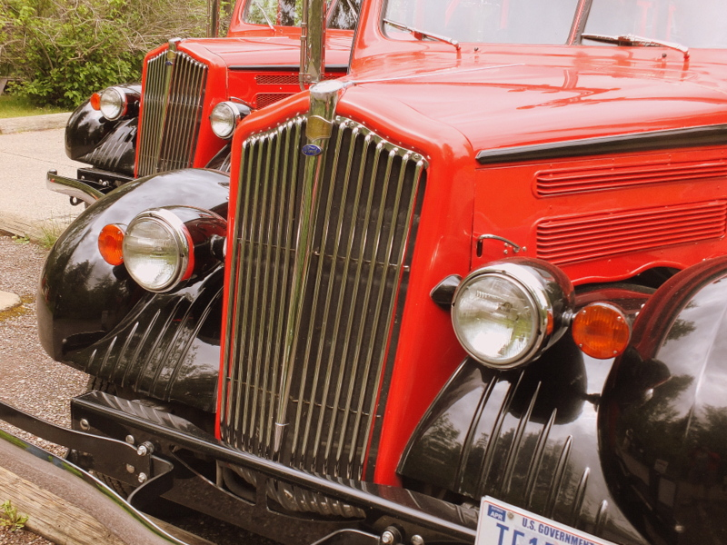 Historic tourist cars at Lake McDonald Lodge