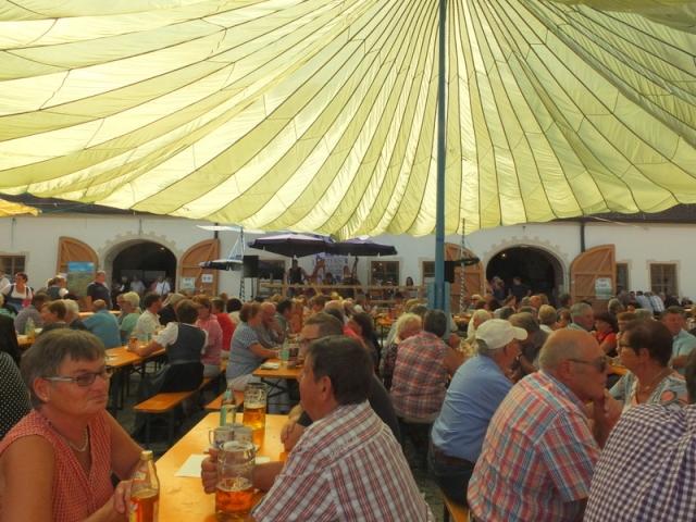 a huge parachute shaded festival-goers