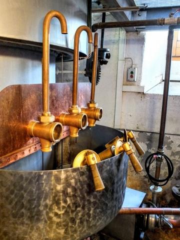 refining apparatus at base of mash tun