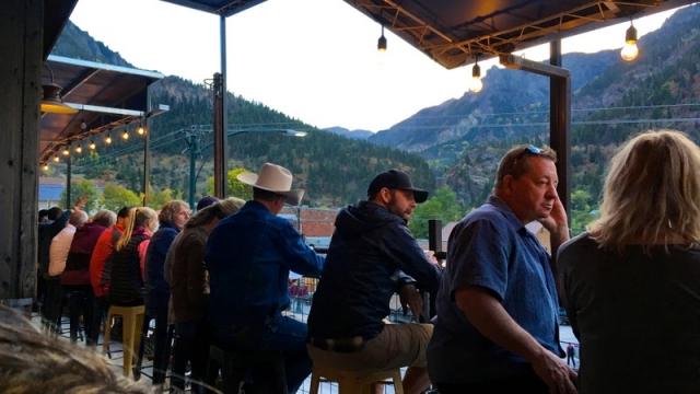 street watchers on the rooftop at Ouray Brewery