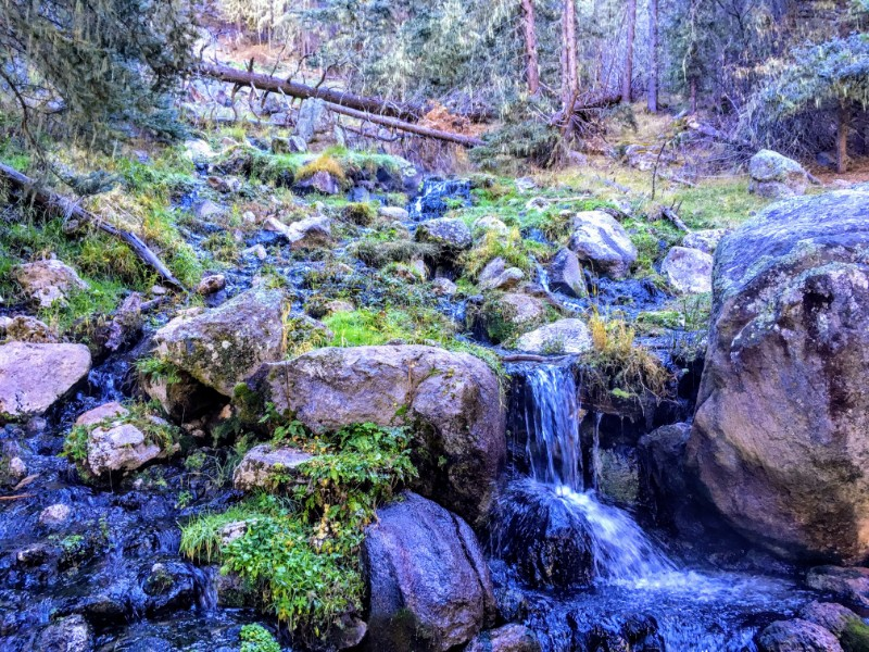 warm stream on hillside below soaking pools