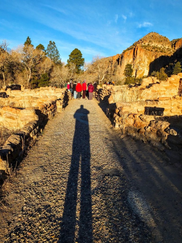 shadow aligns with ancient walkway
