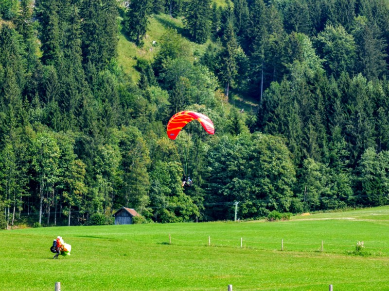 a parasail coming down from Tegelberg