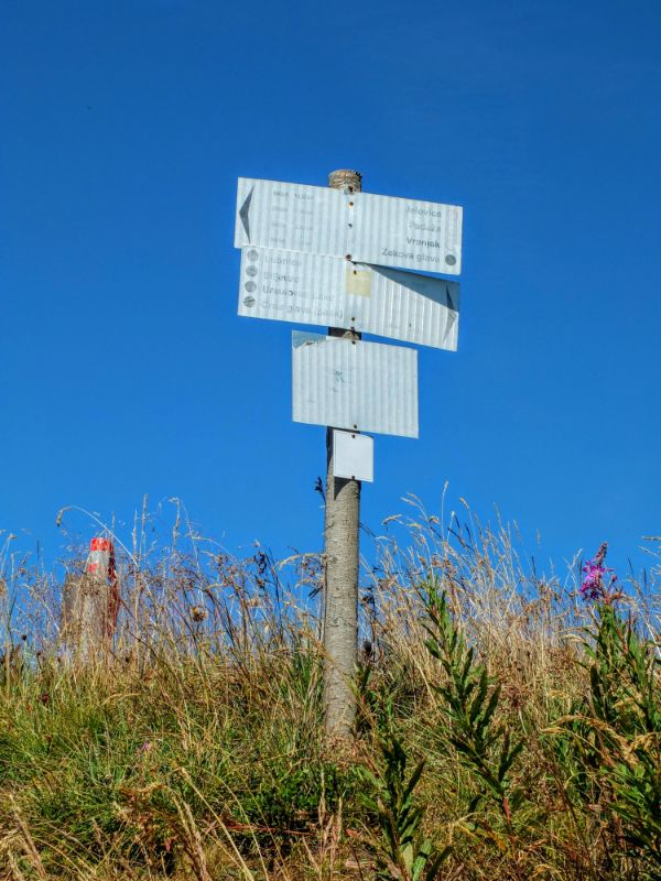weather beaten trail sign