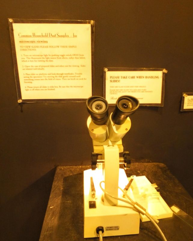 microscope for checking out specimens in the dust collection