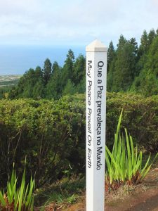 """Signpost: """"May peace prevail in the world"""""""